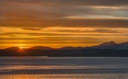 Искра Солнця над звуком Стоковые Фото