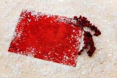 Искра xmas предпосылки рождества освещает текст космоса Нового Года зимнего отдыха карточки красной предпосылки холста веселый Стоковое Изображение