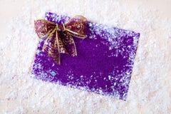 Искра xmas предпосылки рождества освещает текст космоса Нового Года зимнего отдыха карточки красной предпосылки холста веселый Стоковые Изображения RF
