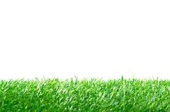 Искусственная дерновина для футбольного поля на белой предпосылке Стоковые Изображения RF