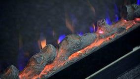 Искусственный накалять electrofireplace освещает конец-вверх контржурным светом видеоматериал