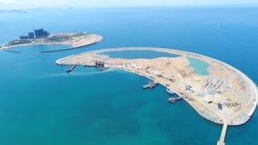 Искусственный остров в море стоковые изображения rf