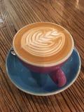 Искусство кофе против деревянной предпосылки Стоковое фото RF