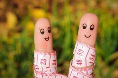 Искусство пальца счастливой пары с метром Стоковые Изображения