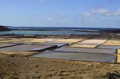 Испания, Канарские острова, остров Лансароте, квартиры соли стоковые фотографии rf