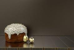 Испеките, золотые яичка на сером цвете предпосылка Стоковые Изображения