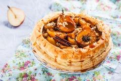 Испеките от облупленного печенья с пряными грушами карамельки Стоковая Фотография