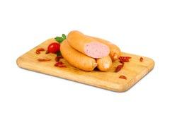 Испеченное мясо на деревянной плите Стоковое Изображение