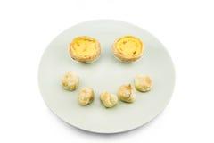 Испеченное тесто пирогов и choux яичка на белой предпосылке Стоковые Фото