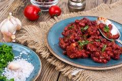 Испеченные горячие фасоли в томатном соусе Стоковое Фото