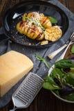 Испеченные картошки hasselback Стоковое Изображение