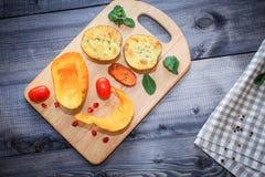 Испеченные куски тыквы, морковей и картошек стоковые фотографии rf