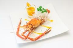 Испеченные crayfish на тарелке Стоковая Фотография