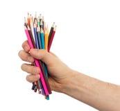 Используемые карандаши в изолированной руке Стоковое Изображение RF
