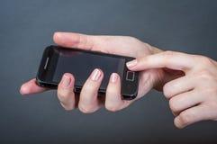 Используя мобильный телефон Стоковое Изображение RF