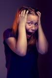 Испуганная предназначенная для подростков девушка стоковое фото