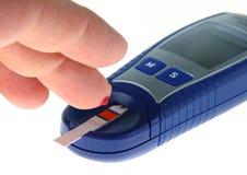 испытание уровня глюкозы крови Стоковые Фото