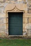 Исследование старой богато украшенной деревянной двери Стоковые Фото