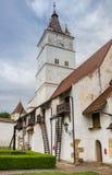 Историческая церковь-крепость в transylvanian деревне Harman стоковая фотография rf