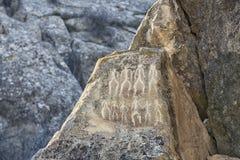 Исторические petrographs Резное изображение датируя назад 10 000 ДО РОЖДЕСТВА ХРИСТОВА Стоковая Фотография RF