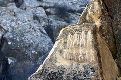 Исторические petrographs Резное изображение датируя назад 10 000 ДО РОЖДЕСТВА ХРИСТОВА Стоковое фото RF