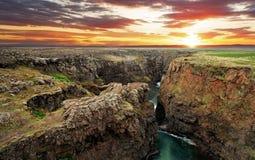 Исландия - каньон Kolugil на заходе солнца стоковые фотографии rf