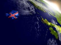 Исландия с флагом в восходящем солнце Стоковая Фотография