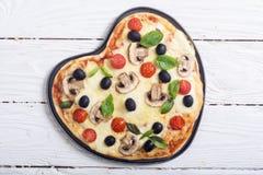 Итальянское сердце пиццы Стоковая Фотография