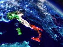 Италия с врезанным флагом от космоса Стоковые Фотографии RF