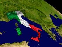 Италия с флагом на земле Стоковое фото RF