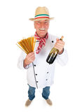 Итальянский кашевар с макаронными изделиями и вином Стоковые Фото