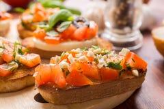Итальянское bruschetta закуски Стоковые Изображения
