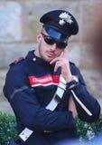 Итальянское carabinieri на улице Флоренса Стоковое Изображение