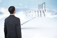 Идентичность против белых шагов водя к открыть двери Стоковая Фотография RF