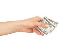 100 и 20 долларов в ` s женщины вручают, изолированный на белизне Стоковые Изображения