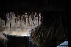Идти дождь на бамбуковой хате Стоковое фото RF