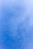 Идти снег на голубом небе Стоковая Фотография RF