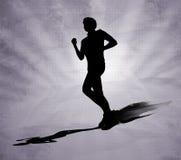 Идущий силуэт черноты человека на серой предпосылке Стоковые Фото