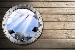 Иллюминатор металла с ландшафтом хляби моря иллюстрация штока