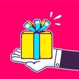 Иллюстрация вектора руки держа желтую подарочную коробку Стоковое Фото