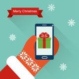 Иллюстрация вектора с Рождеством Христовым Smartphone владением рук Санта Клауса плоская Стоковые Изображения