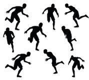 Иллюстрация вектора EPS 10 силуэта футболиста в черноте Стоковое Фото
