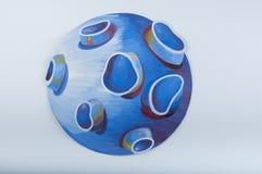 иллюстрация Голубая планета нарисованная гуашью на белой предпосылке Стоковое фото RF