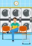 Иллюстрация сидя человека в loundromat бесплатная иллюстрация