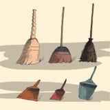 Иллюстрация с вениками и dustpans Стоковое фото RF
