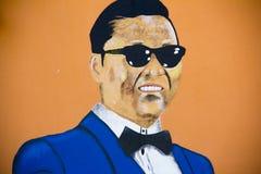 Иллюстрация Psy на стене Стоковая Фотография