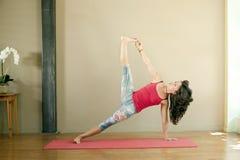 йога женщины vasisthasana Стоковое Изображение RF