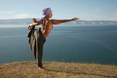Йога около озера Стоковое фото RF