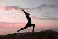Йога утра молодой женщины Стоковое Изображение