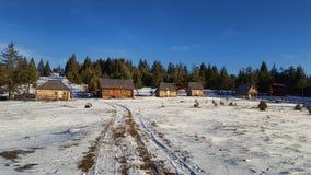 Кабины в снеге Стоковые Фото